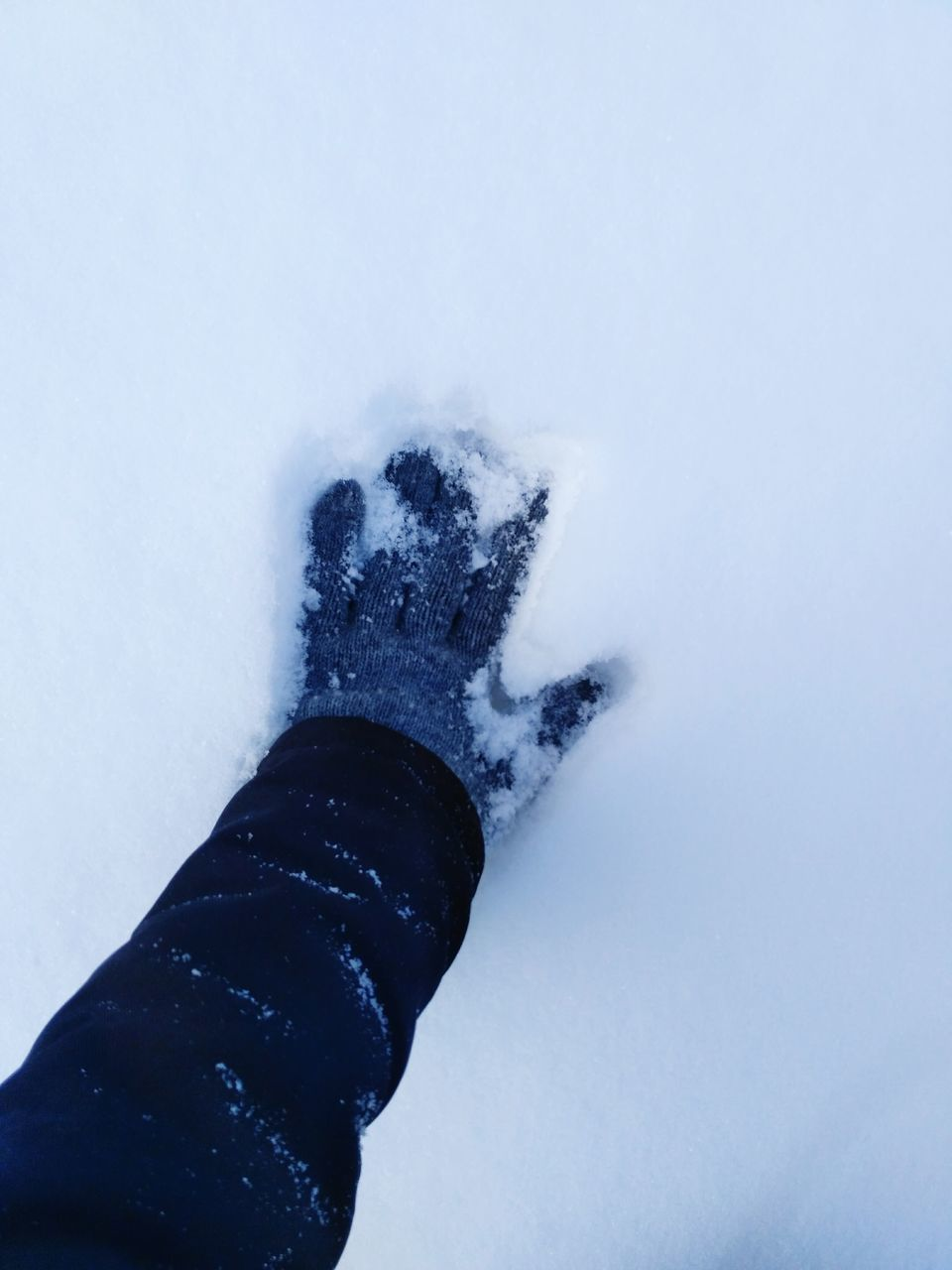 snow, one person, winter, human body part, personal perspective, real people, high angle view, human hand, cold temperature, low section, human leg, outdoors, day, close-up, nature, people