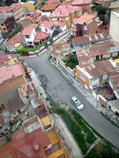 View of La Paz streets from the Teleferico. La Paz, Bolivia. La Paz, Bolivia Aerial View Architecture Building Exterior Built Structure City Cityscape Day High Angle View House Nature No People Outdoors Residential  Residential Building Road Town Transportation