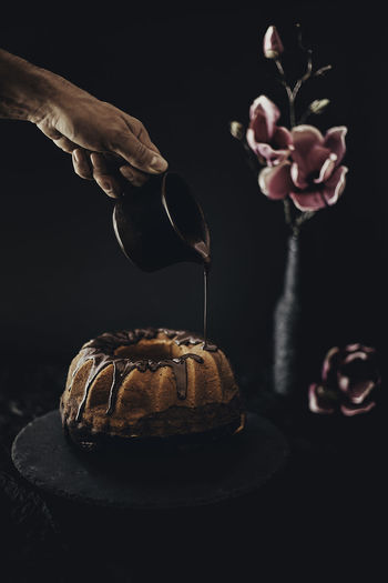 pouring cake Celebration Chocolate Dessert Baked Black Background Cake Dessert Flower Food Food And Drink Gugelhupf Human Hand Marmorkuchen Pouring Sweet Food Table