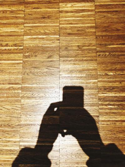 Shadow of person on hardwood floor