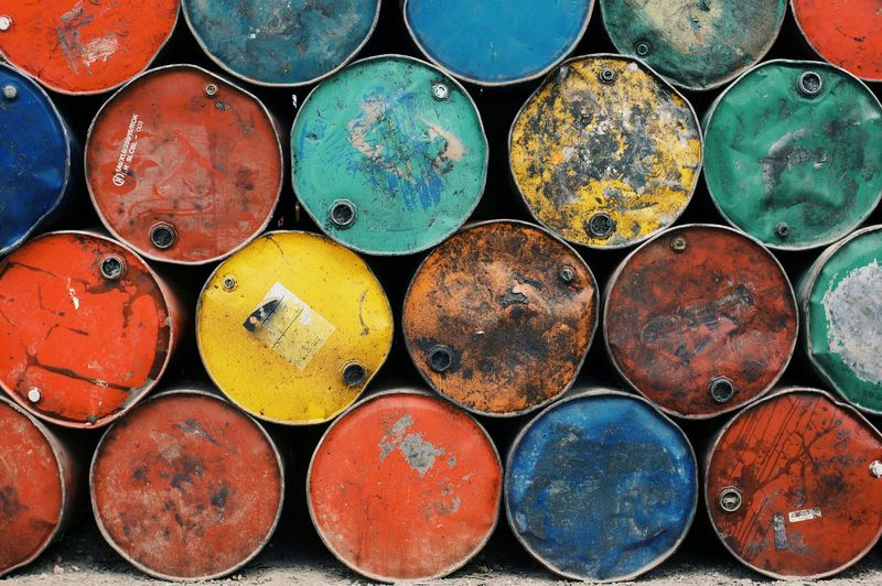Full Frame Shot Of Colorful Rusty Metallic Barrels Stack