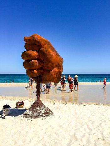 Fist: Sculptures by the Sea 2016 Fist Hand March 12,2016 Modern Art Arts Festivals Cottesloe Beach Tourist Attraction  Western Australia Sculptures Sculptures By The Sea Abstract Art Arts Interactive  Culture Arts And Entertainment People Sand Beach Indian Ocean Travel Destinations Leisure Activity Fist Sculpture Three-dimensional Grip ArtWork