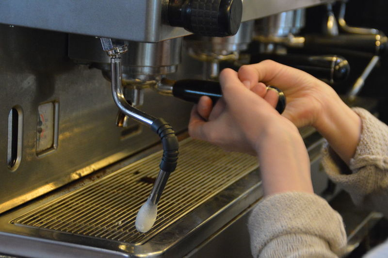 Cropped Image Of Barista Using Espresso Maker In Cafe