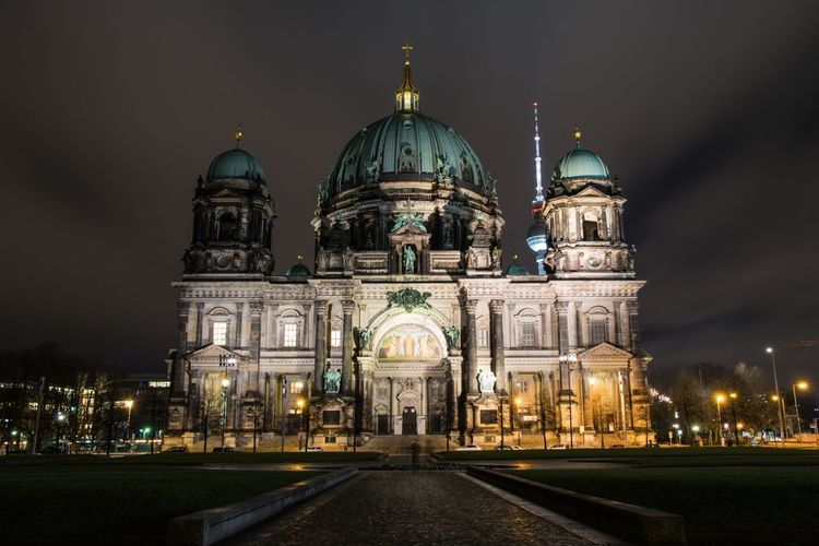 Low angle view of illuminated berlin cathedral against sky at night