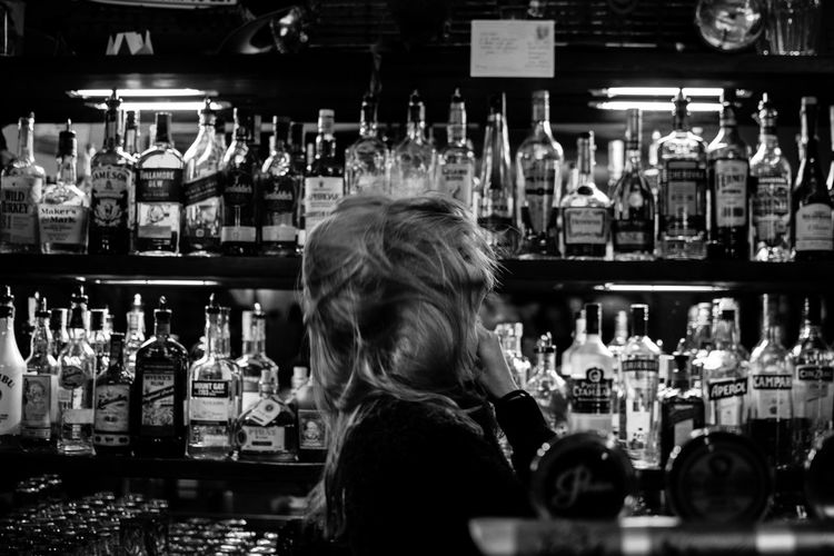 Side View Of Young Woman Dancing At Bar