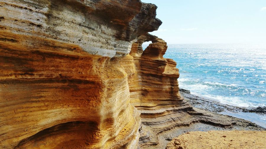 ERODED ROCK FORMATIONS ON THE SEASHORE