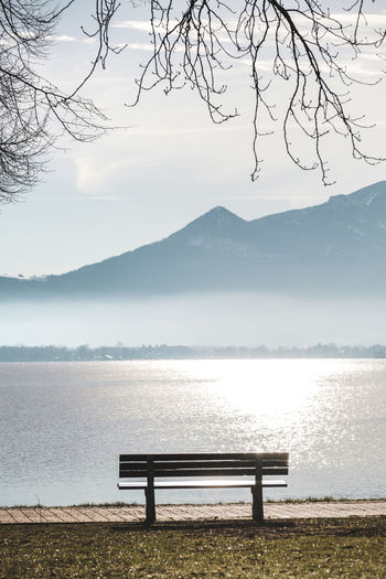 Bench Beauty In Nature Water Lake Tranquility Mountain Seat Nature Tranquil Scene Sky Scenics - Nature Idyllic Day Tree Non-urban Scene Outdoors Park Bench No People Empty Chiemsee
