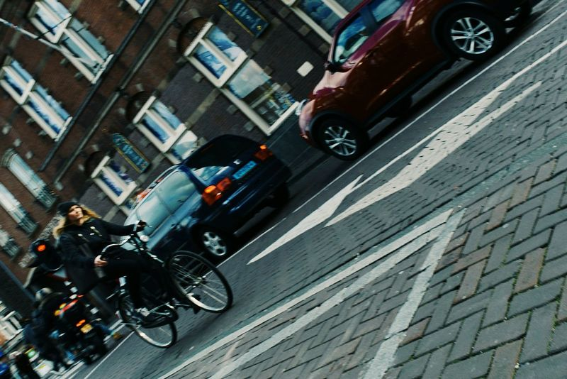 Photography In Motion Enjoying Life Bicycle Cars Streetphotography Street Photography Buildings Woman On A Bicycle Driving Car Architecture Buldings EyeEm Best Shots Street Photo Amsterdam Netherlands Holland Your Amsterdam