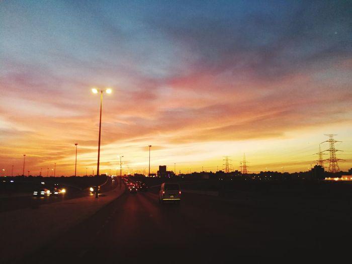 Sunset Sky Cloud - Sky Car Traffic Land Vehicle City Life No People Nature Outdoors Day Urban Skyline