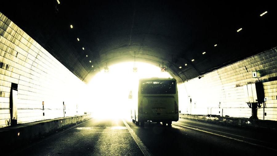 开车长途中,最怕钻山洞,灯影如穿梭,摇摇睡意重。 tunnel Transportation Tunnel Road Travel Land Vehicle Direction The Way Forward