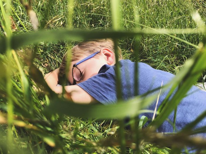 Sleeping in the grass Relaxing One Person Plant Real People Portrait Headshot Leisure Activity Nature Day Glasses Young Adult Grass Green Color Outdoors