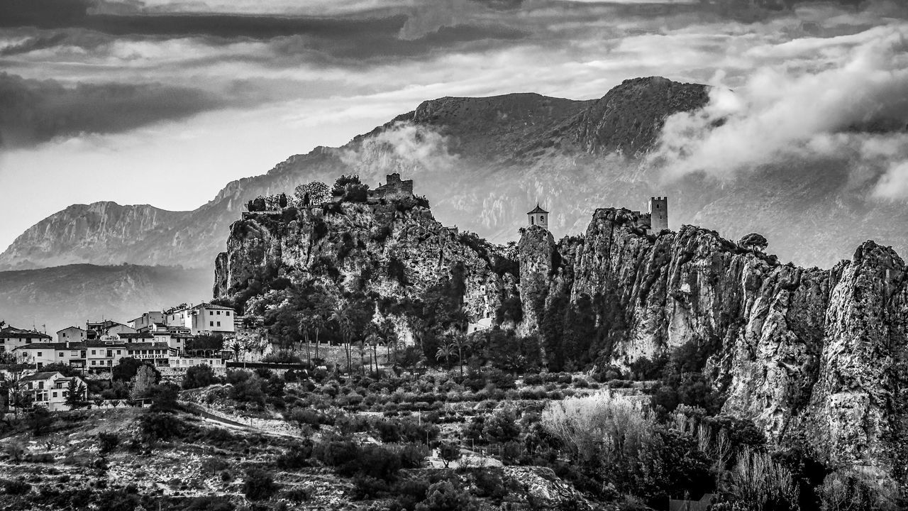 The castle of Guadalest During Sunset in Black and White Alicante Colourful Evening Light SPAIN Spain♥ Architecture Beauty In Nature Built Structure Castel Castello Cloud - Sky Day Guadalest Landscape Mountain Mountain Range Nature No People Outdoors Physical Geography Rock - Object Scenics Sky Sundown Sunset Tranquility Travel Destinations Tree Go Higher