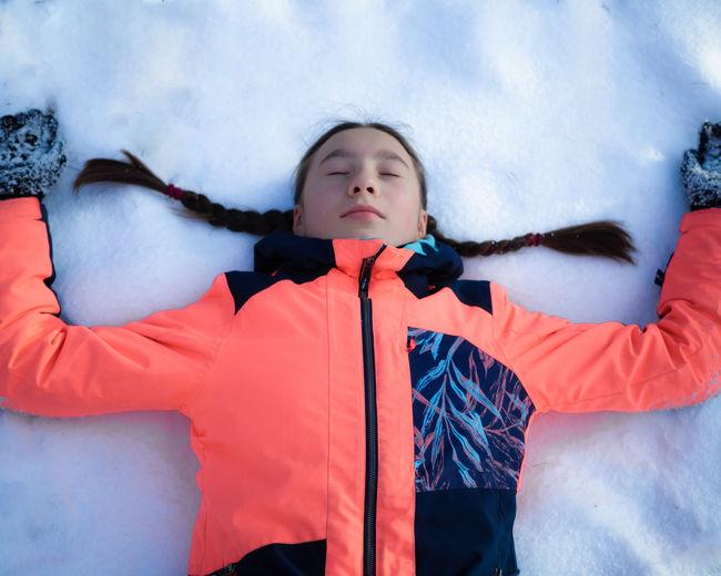 Girl lying down in snow