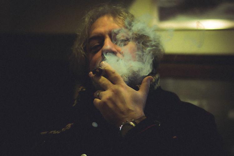 Close up of mature man smoking cigar