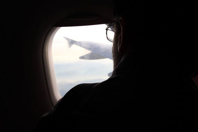 Close-up of man seen through window