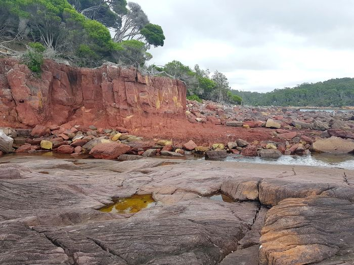 ancient red rocks formed during the Devonian period (360 million years ago) at Ben Boyd National Park near Eden on the NSW South Coast, Australia. Rock Devonian Ben Boyd National Park Ben Boyd National Park Beach Ben Boyd National Parl Nsw Sapphire Coast New South Wales  Bittangabee Bay Bay Australia Rock - Object Outdoors Cloud - Sky Day No People Nature Sky Coast Sand Shore Eroded Geology