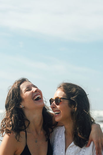 50mm Brazil Girl Power Happiness Laughing Praia Sisters Sunny The Week on EyeEm Beach Beauty In Nature Canon Canonphotography Day Girl Laugh Outdoors Sky Sol The Portraitist - 2018 EyeEm Awards Human Connection