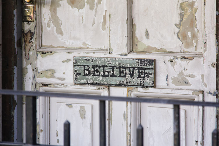 Close-up of text on old door