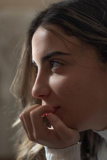 Close-up of thoughtful teenage girl