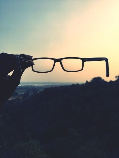 valleys ❤️🌅 Sunset Human Hand Silhouette Human Body Part Sky One Person Nature Outdoors Eyeglasses