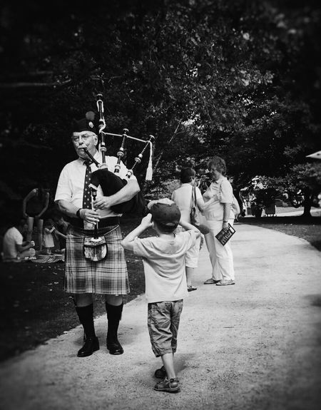 Some like it and some don't... Bagpipes Bagpiper Piper Highland Games Streetphotography Streetphoto_bw Bw_collection Blackandwhite Streetscene Street Musicians Street Music Marching Little Boy Musician Men In Kilts Kilt On The Way Showcase July People Watching People Together Monochrome Photography TakeoverMusic Resist The Street Photographer - 2017 EyeEm Awards