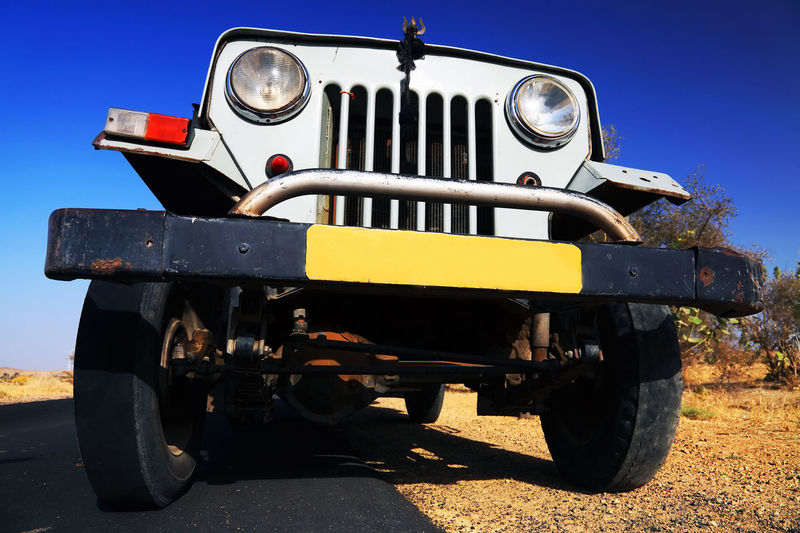 Low Angle View Of Off-Road Vehicle On Road