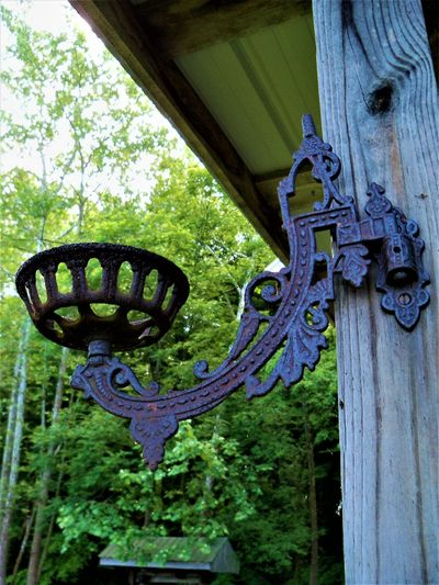 Antique Metal Wall Sconce Antique Candle Holder Country Living Indiana Old-fashioned Roof Trees USA Wood Art Cabin Cabin In The Woods Close-up Country Life Metal Metal Art Metallic Metalwork Old Porch Life Sconce Trees And Sky Wall Sconce Wooden Post Woods