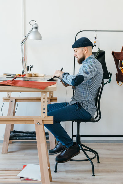 Adult Adults Only Business Businessman Busy Creative Designer  Indoors  Leather Male Manual Worker Modern One Man Only One Person Only Men Owner People Professional Small Business Studio Studio Photography Table Working Workplace