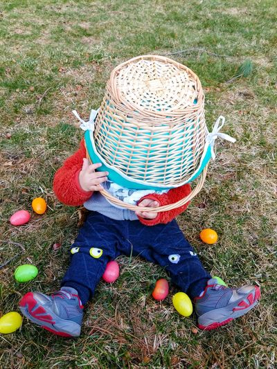 High angle view of boy wearing hat on field