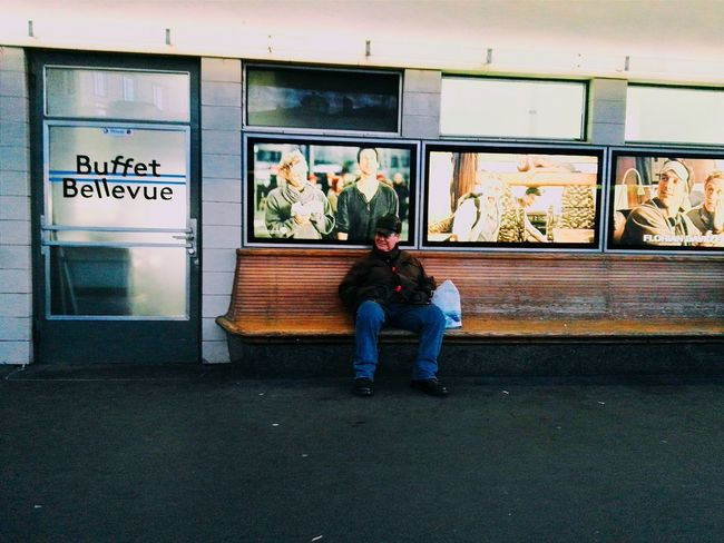 From A Tramway Window Snapshot One Person Lonely but Happy The Man With The Hat Sitting On A Bench Waiting Place To Be  Bellevue Tramstation Everyday Lives
