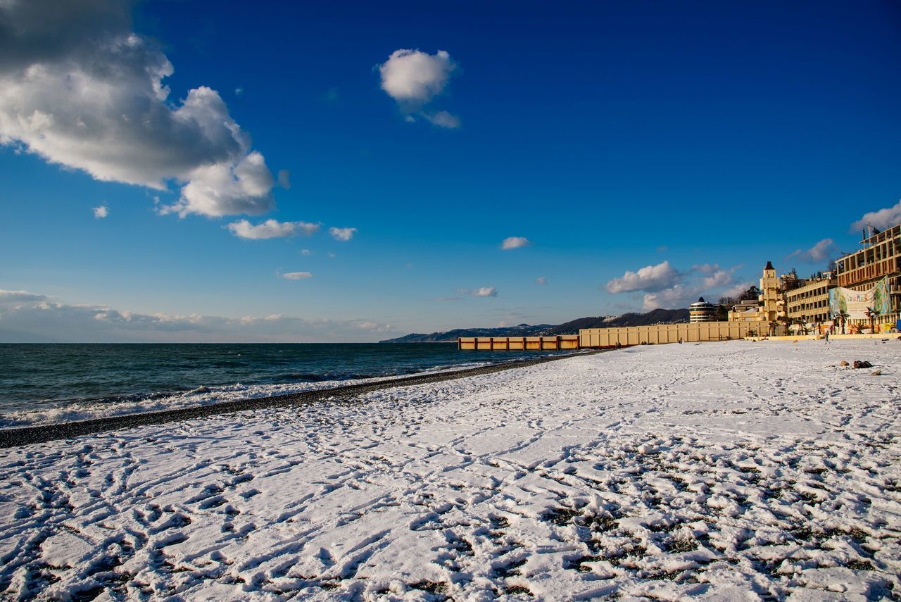 sky, beach, cloud - sky, sea, water, architecture, built structure, outdoors, nature, blue, day, scenics, no people, tranquil scene, building exterior, sunlight, sand, travel destinations, beauty in nature, horizon over water