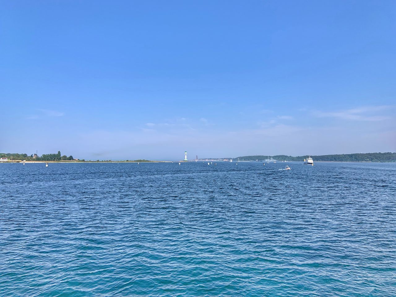 water, sea, blue, scenics - nature, sky, beauty in nature, waterfront, tranquil scene, tranquility, nautical vessel, no people, day, nature, transportation, idyllic, non-urban scene, outdoors, copy space, mode of transportation, sailboat