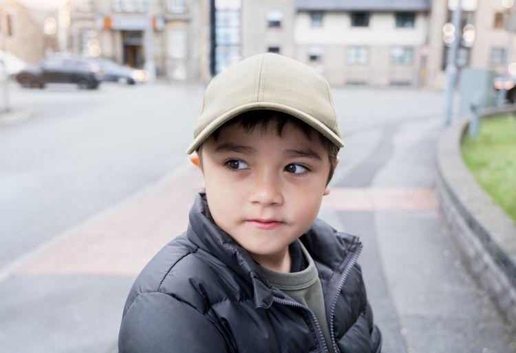 Portrait of boy in city