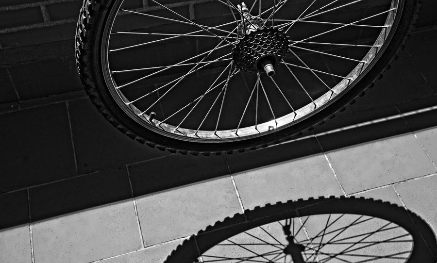 Bike wheel and its shadow Bicycle Black And White Contrast Minimalism Minimalist Mode Of Transport No People Outdoors Shadows Shadows And Light Spoke Tire Transportation Wheel
