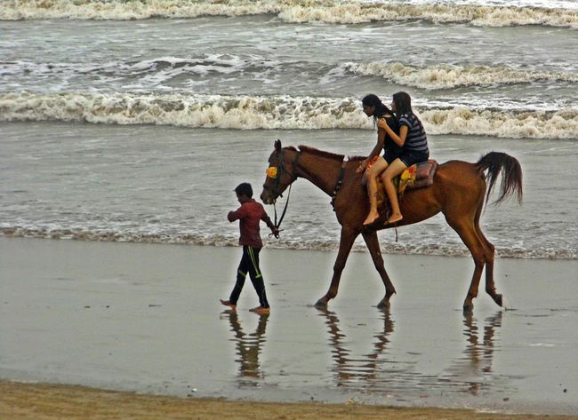 Lets Ride Beach Beach Life Beach Photography Beach Walk Beachphotography Carefree Friendship Full Length Horizon Over Water Leisure Activity Lifestyles Outdoors Real People Recreational Pursuit Sand Sea Shore Standing Togetherness Vacations Water Wave Weekend Activities
