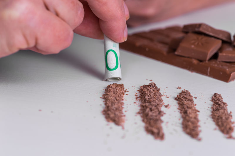 Cropped Hand Snorting Cannabis Chocolate