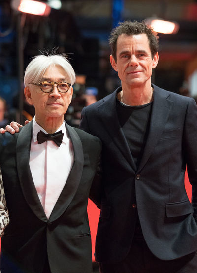 Berlin, Germany - February 24, 2018: Japanese musician and member of the jury Ryuichi Sakamoto and German jury president Tom Tykwer pose on red carpet before the awards ceremony of the 68th Berlinale AWARD Closing Ceremony Film Festival Ryuichi Sakamoto Tom Tykwer Arts Culture And Entertainment Berlinale Berlinale 2018 Berlinale Festival Berlinale2018 Berlinale68 Entertainment Entertainment Event Focus On Foreground Jury Member Jury President Looking At Camera Mass Media People Posing Posing For The Camera Red Carpet Red Carpet Event Smiling Two People