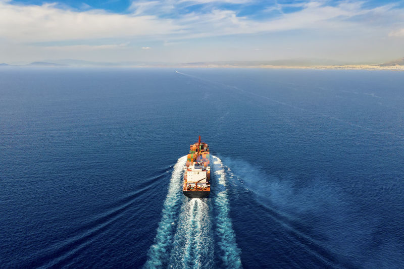 High angle view of boat in sea against sky