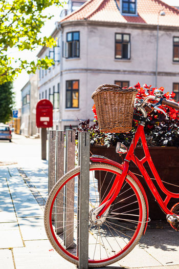 Bicycle parked in front of building
