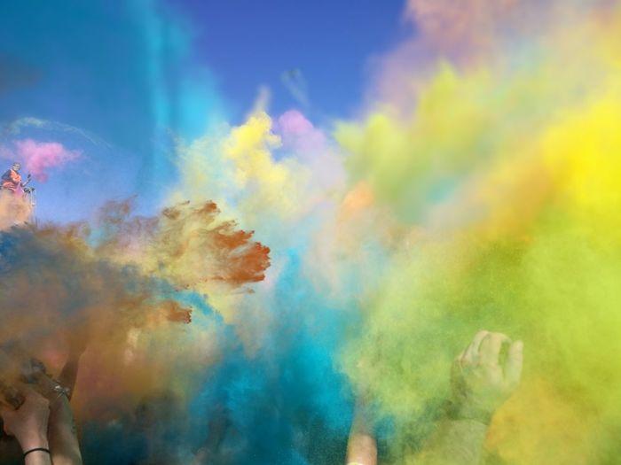 People splashing powder paints during holi celebration
