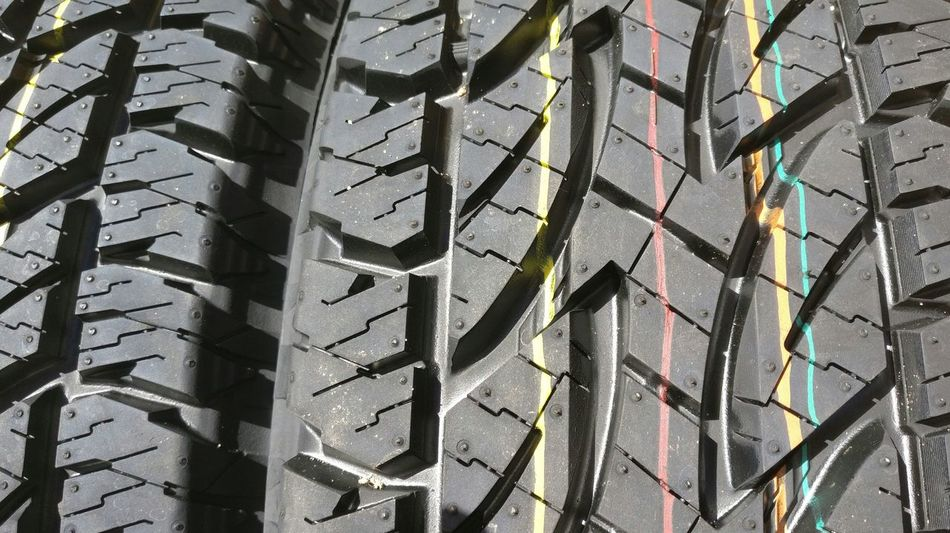 New shoes. Through My Lens Tyreporn Abstract Close-up Timeless Yellow Wheel Full Frame Backgrounds Pattern No People Day Outdoors Tire Rubber Textured  Sunlight Architecture Low Angle View Nature Metal Transportation