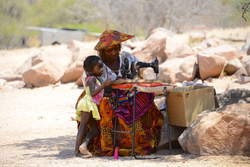 Herero women in Namibia Herero Tribe Namibia Sewing Sewing Machine Africa Day Herero Lifestyles Outdoors People Tribe Two People
