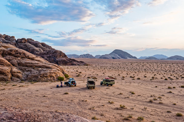 Wadi Rum picnic Beauty In Nature Cars Clouds And Sky Desert Jordan Landscapes Middle East Mountains Nature Non-urban Scene People Picnic Rock Formation Scenics Sky And Clouds Tourist Travel Travel Photography Wadi Rum 43 Golden Moments The Essence Of Summer People Together People And Places