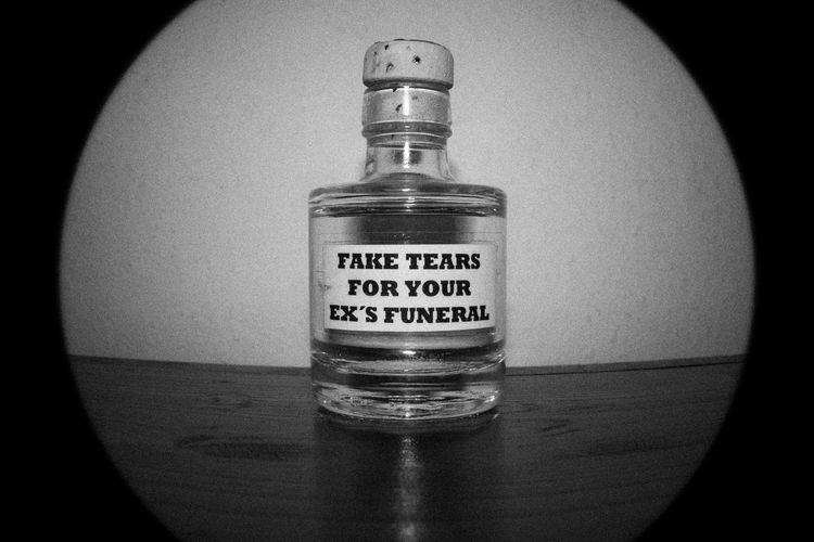 Fake tears for your ex's funeral. FILIPPI GIULIA PHOTOGRAPHY. All rights reserved. ArtWork Artist Artistic Creativity Love Text Typography Art Blackandwhite Bottle Canon Close-up Communication Creative Design Fisheye Glass Indoors  Light And Shadow Message People Photographer Photography Studio Shot Women