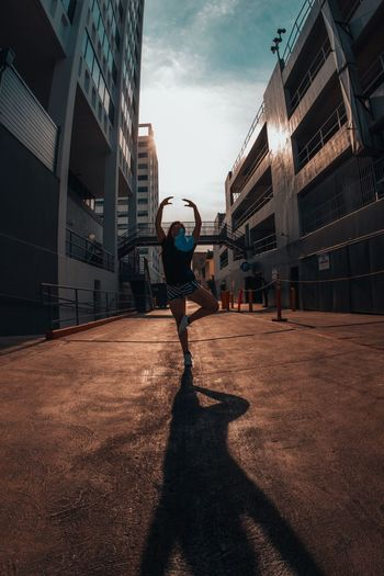 SunDance Dance Dancing City City Life Silhouette Shadow One Person Sports Clothing Built Structure Architecture Sportsman Lifestyles Women Healthy Lifestyle Building Exterior Real People