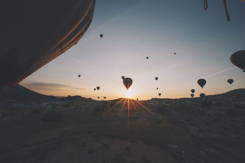 EyeEmNewHere Travel Flying Mid-air Hot Air Balloon Air Vehicle Transportation Sunset Ballooning Festival Sky Outdoors Adventure Nature Landscape No People Mountain Extreme Sports Beauty In Nature Parachute Day
