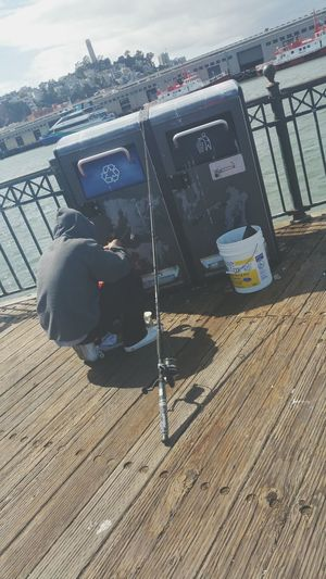 Telling Stories Differently Baiting Fish Hook Check This Out Hungry Getting Food Young Man Fishing Pier The Street Photographer - 2016 EyeEm Awards