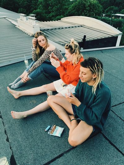 Rooftop Women Fashion Leisure Activity Women Lifestyles Group Of People Young Adult Friendship Young Women Togetherness Girls Females Happiness Urban Fashion Jungle