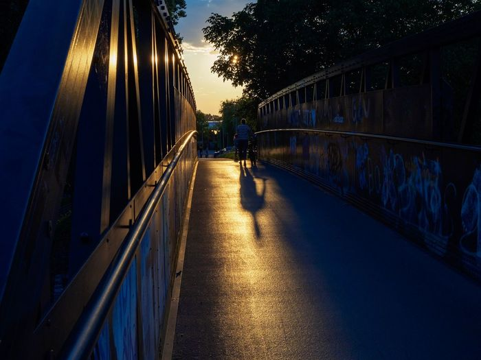 Silhouette of bridge against sky at sunset