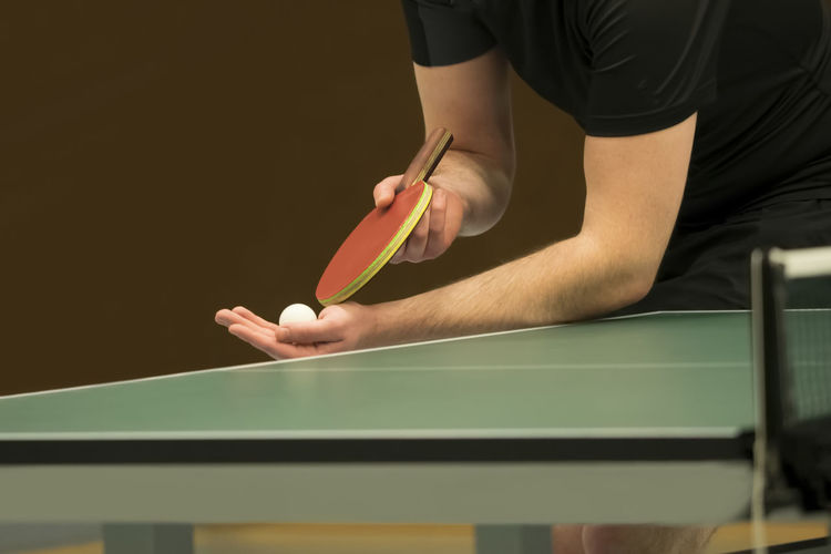 table tennis player serving, closeup Adult Day Human Body Part Human Hand Indoors  Lifestyles Men One Person People Player Real People Serving Skill  Snooker Sport Table Tennis